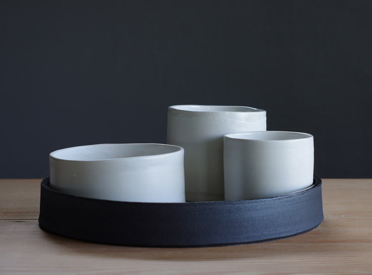 black stoneware and white porcelain nesting set